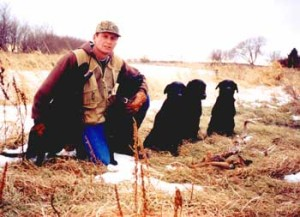 Hunter with black labs